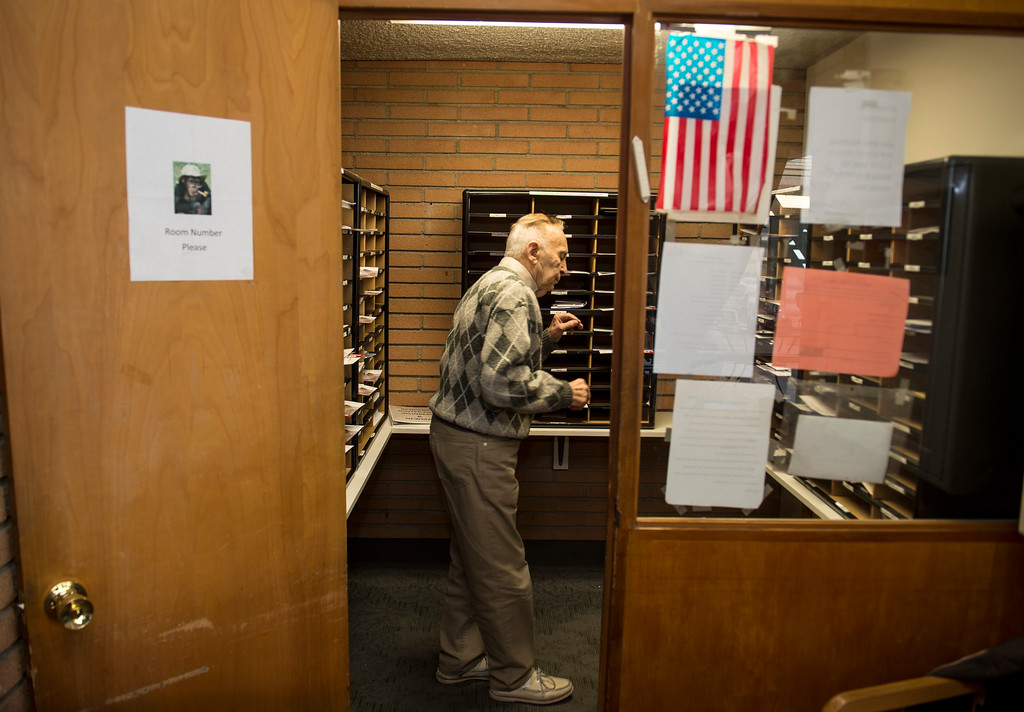 . Joseph Neustadt, 89, mans the mail room at the Los Angeles Jewish Home for the Aging-Eisenberg Village in Reseda on Wednesday, January 25, 2017. Joseph Neustadt who was born and raised in Riga Latvia, Baltic states, was the lone survivor of the Holocaust from his immediate family. He says at the age of 14 he was placed in a concentration camp for 4 years, he lost his mother, father, two sisters and a brother during World War II. Photo by Ed Crisostomo, Los Angeles Daily News/SCNG)