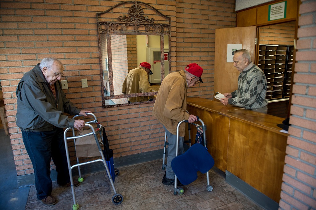 . Joseph Neustadt, right, 89, mans the mail room at the Los Angeles Jewish Home for the Aging-Eisenberg Village in Reseda on Wednesday, January 25, 2017. Joseph Neustadt who was born and raised in Riga Latvia, Baltic states, was the lone survivor of the Holocaust from his immediate family. He says at the age of 14 he was placed in a concentration camp for 4 years, he lost his mother, father, two sisters and a brother during World War II. Photo by Ed Crisostomo, Los Angeles Daily News/SCNG)