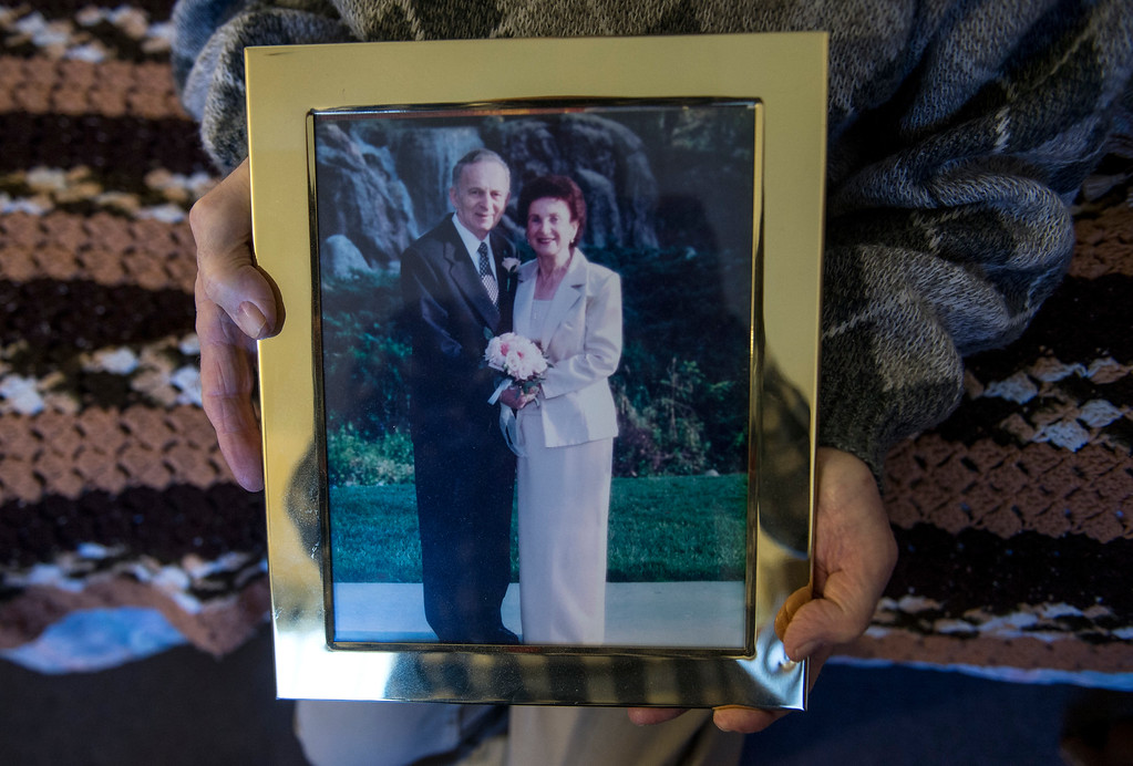 . Joseph Neustadt, 89, shows a photograph of himself with his wife Frances, in his room at the Los Angeles Jewish Home for the Aging-Eisenberg Village in Reseda on Wednesday, January 25, 2017. Joseph Neustadt who was born and raised in Riga Latvia, Baltic states, was the lone survivor of the Holocaust from his immediate family. He says at the age of 14 he was placed in a concentration camp for 4 years, he lost his mother, father, two sisters and a brother during World War II. Photo by Ed Crisostomo, Los Angeles Daily News/SCNG)