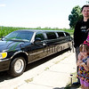 Shane Walters poses for a picture with his family Penny, Kaylee, 4, and Madison, 1, and his Lincoln Town Car limousine he uses for his new business Red Carpet Limo Service.