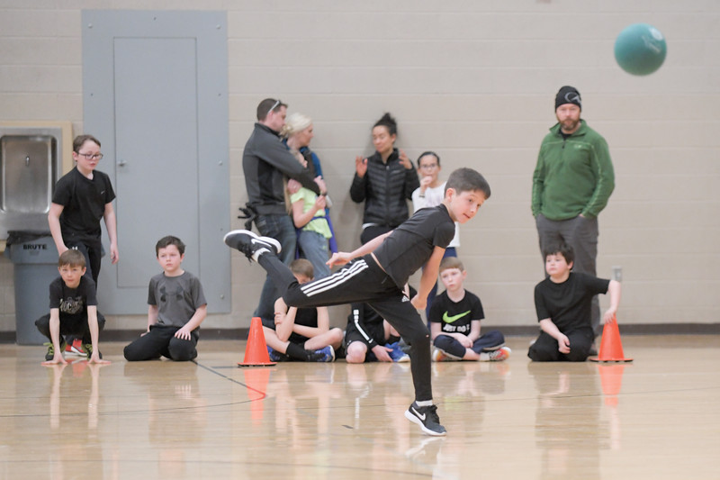 Matthew Gaston | The Sheridan Press<br>D-Town hurler Carter McMullen, 9, launches a dodgeball at the opposition during the KidsLife Dodgeball tournament Saturday, March 9, 2019.