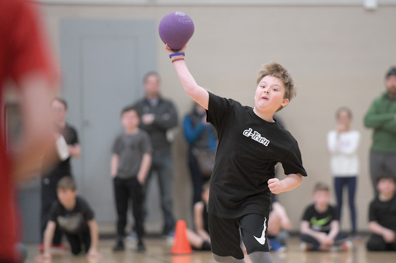 Matthew Gaston | The Sheridan Press<br>Karson Phipps, 9, launches a dodgeball during the KidsLife Dodgeball tournament at Sheridan High School Saturday, March 9, 2019.