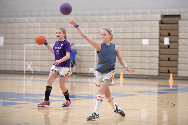 Matthew Gaston | The Sheridan Press<br>From left, Mia and Gabriella Rabon of the Crazy Crew launch a coordinated assault during the KidsLife Dodgeball tournament Saturday, March 9, 2019.