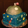 Space cake with moon and astronaut