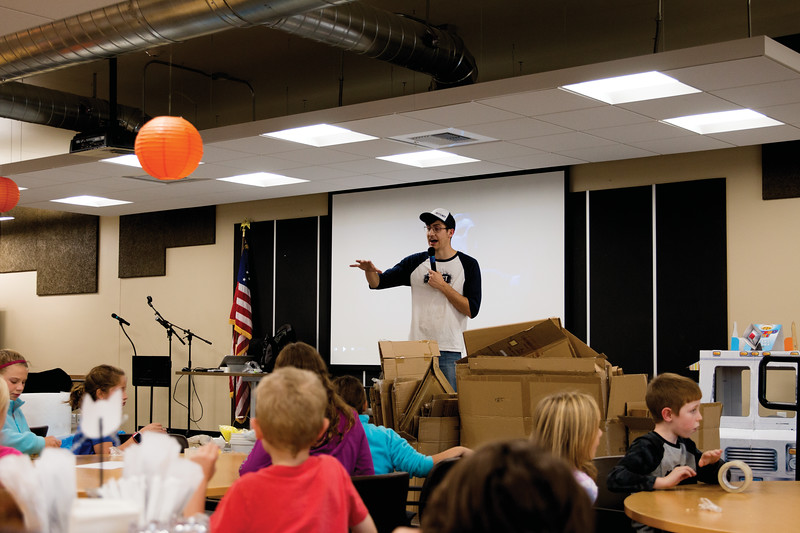 Matthew Gaston | The Sheridan Press<br>Keegan Jenness explains the rules of the contest to the childern gathered for the Kids Life/Impact Pumpkin Drop at The Hub Friday, Oct. 19, 2018.