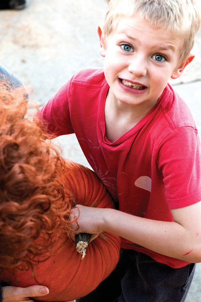 Matthew Gaston | The Sheridan Press<br>Seven-year-old Waylon Hape, requests some help with the massive pumpkin his group chose for the pumpkin drop contest Friday, Oct. 19, 2018.