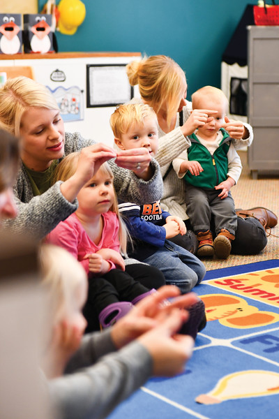"Matthew Gaston | The Sheridan Press<br>From left, Sarah Houghton with her daughter Emma, 3, and Tristan Williams, 3, with his mom Lauren and 1-year-old brother Braedyn, sing the ""Itsy Bitsy Spider"" at Kindlers Wednesday, Jan. 9, 2019."