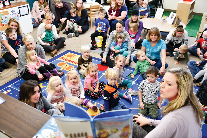 Matthew Gaston | The Sheridan Press<br>Jeriann Jacobson, right, reads a book about a penguin named Tacky to Kindlers and their parents at Highland Park Elementary School Wednesday, Jan. 9, 2019.