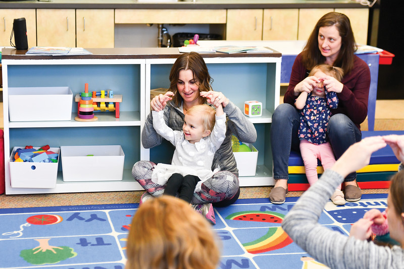 Matthew Gaston | The Sheridan Press<br>From Left, Heather Sorenson, 3-year-old Piper Sorenson, Erin Hanson and 19-month-old Ella Hanson sing songs to start off the day at the Kindlers program Wednesday, Jan. 9, 2019.