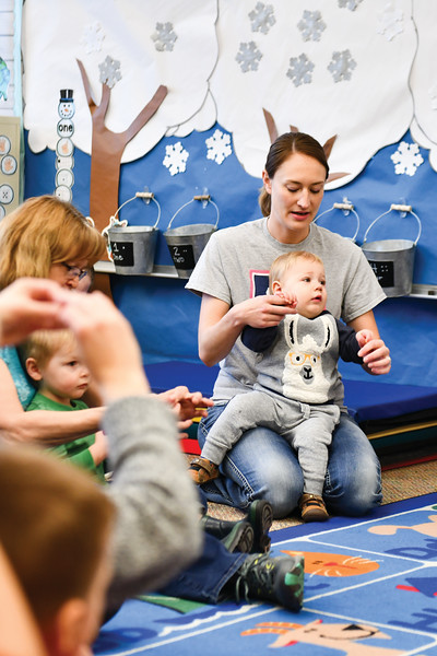 Matthew Gaston | The Sheridan Press<br>Nineteen-month-old Liam and his mom, Aimee Miachkov, dance along during the sing-along portion of Kindlers Wednesday, Jan. 9, 2019.