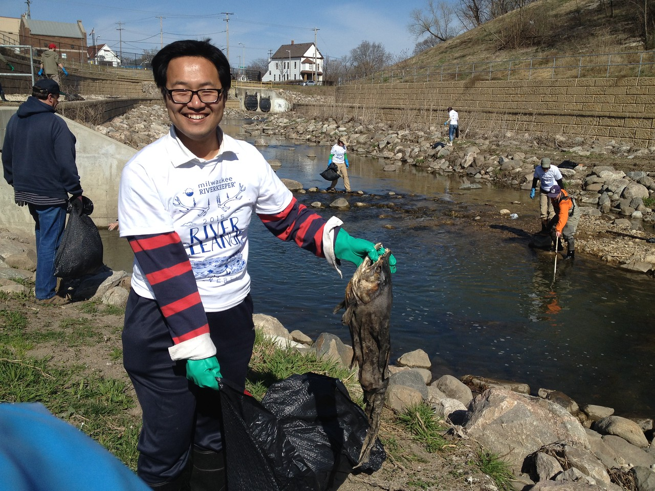 Yu Li shows the carcass of a dead fish.  Fortunately, there were many more migrating fish seen and this the only dead fish found.