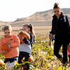 Matthew Gaston | The Sheridan Press<br>Sonorah Willis (5) and Jeules Busch (5), from left, are accompined by Jeules mother Candice Busch on a field trip to Koltiska's Pumpkin Patch to pick out pumpkins for a class project on Tuesday, Sept. 18, 2018.