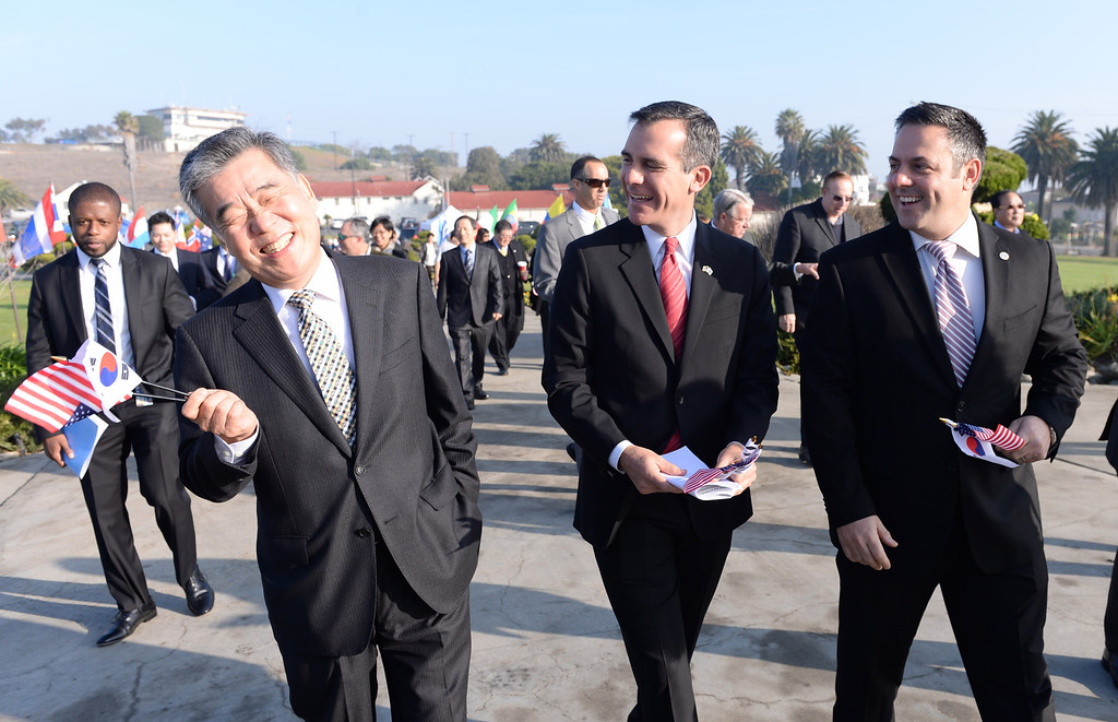 . San Pedro Korean Friendship Bell ceremony to re-dedicate the recently restored bronze monument. Korean Consul General Shin Yeon Sung, left, has a laugh with LA Mayor Eric Garcetti and Councilman Joe Buscaino as they arrive at the event.  (Jan 10, 2014. Photo by Brad Graverson/The Daily Breeze)