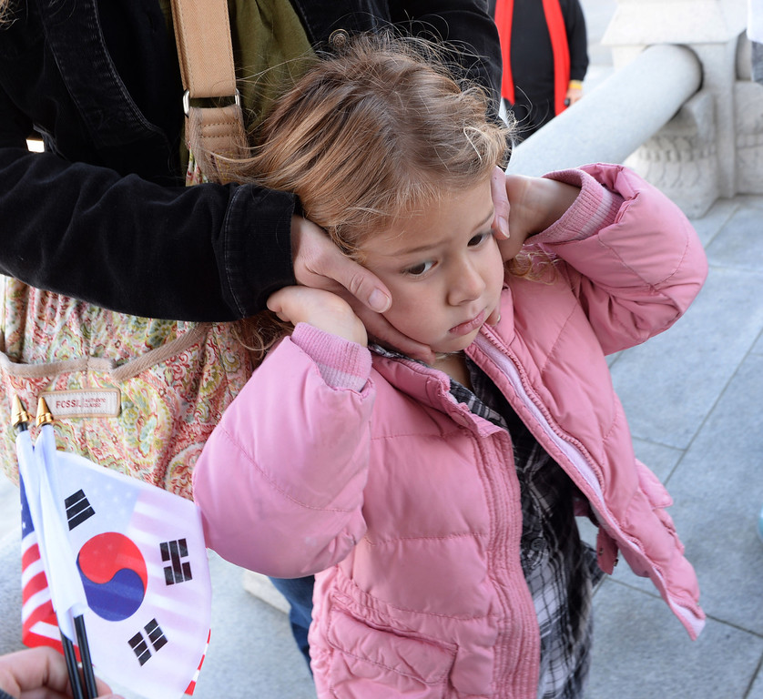 . San Pedro Korean Friendship Bell ceremony to re-dedicate the recently restored bronze monument. Sabine Hughey, 4, of San Pedro throught all the bell ringing was a bit too loud.  (Jan 10, 2014. Photo by Brad Graverson/The Daily Breeze)