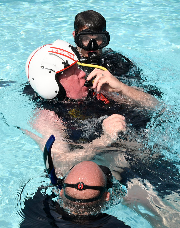 . March 17,2017. Santa Clarita  CA. New LA county fire Air and USAR operations personnel undergoing Helicopter Underwater Egress Training (HUET) at the Santa Clarita Pool. The training  involve simulated sinking exercises to prepare New Air Operations personnel for emergency exit procedures in situations where a crash landing over water may be required.  Photo by Gene Blevins/LA DailyNews/SCNG
