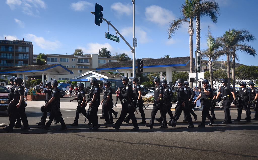 . Police officers from various departments, including Laguna Beach and Huntington Beach, Newport Beach and Irvine, create a line separating the protesters in an attempt to prevent clashes during a demonstration in Laguna Beach. Mindy Schauer, Orange County Register/SCNG