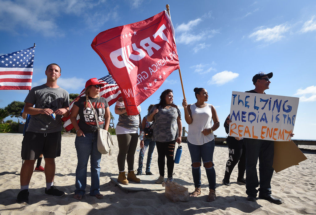 . Pro Trump demonstrations gather at Pacific Coast Highway near Broadway in Laguna Beach for an illegal immigration protest.  Mindy Schauer, Orange County Register/SCNG