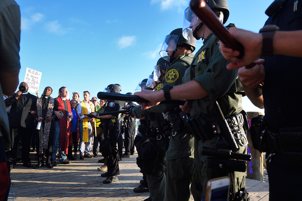 . Orange County Sheriff Deputies keep demonstrators from opposing sides separated from each other. Kevin Sullivan, Orange County Register/SCNG