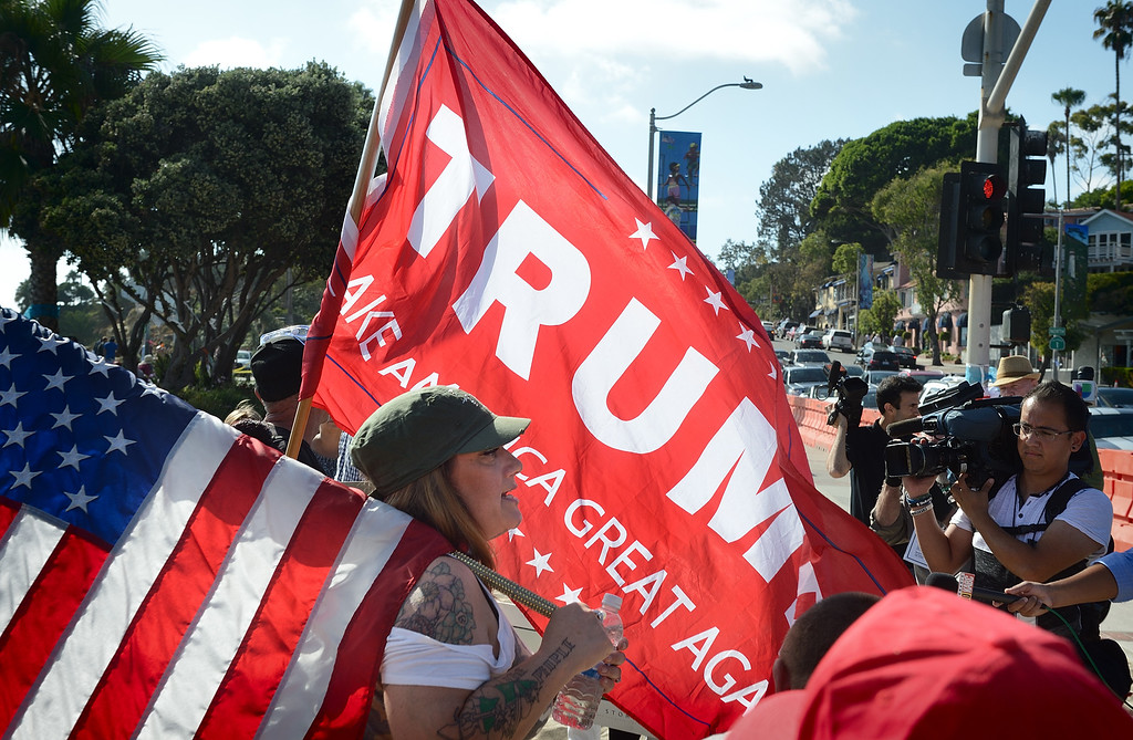 . People gather in on Pacific Coast Highway in Laguna Beach for a protest. Kevin Sullivan, Orange County Register/SCNG