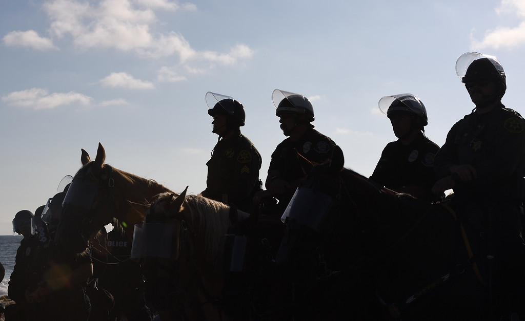 . Police and Sheriff Mounted Unites stand by during a Laguna Beach protest. Mindy Schauer, Orange County Register/SCNG