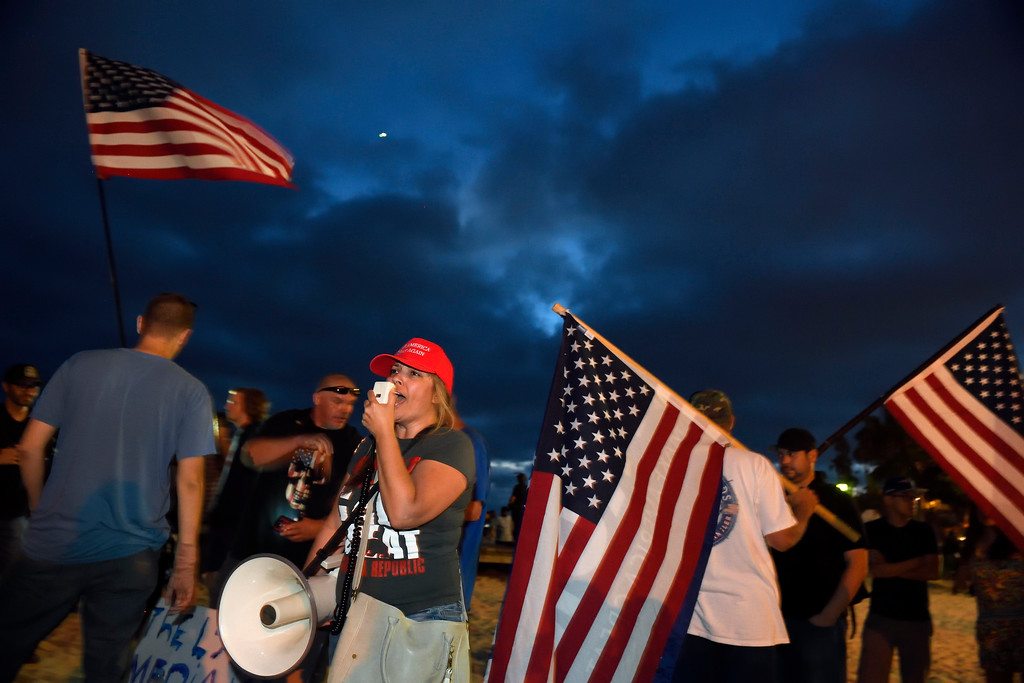 . Protesters yell during a demonstration on Main Beach in Laguna Beach Sunday August 20, 2017. (Kevin Sullivan, Orange County Register/SCNG