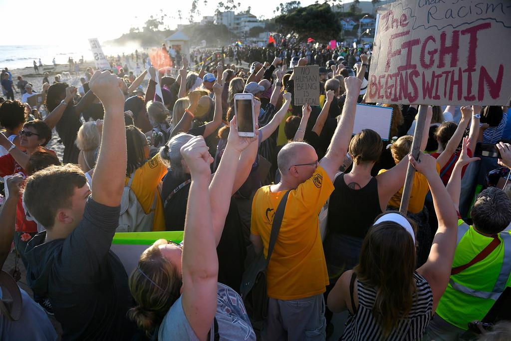 . Demonstrators gather on the beach in Laguna Beach. Kevin Sullivan, Orange County Register/SCNG