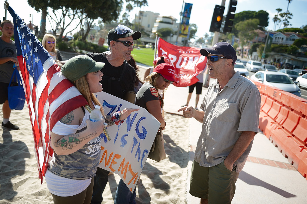 . Protesters gather on the beach at Pacific Coast Highway near Broadway in Laguna Beach for a protest on illegal immigration. Kevin Sullivan, Orange County Register/SCNG