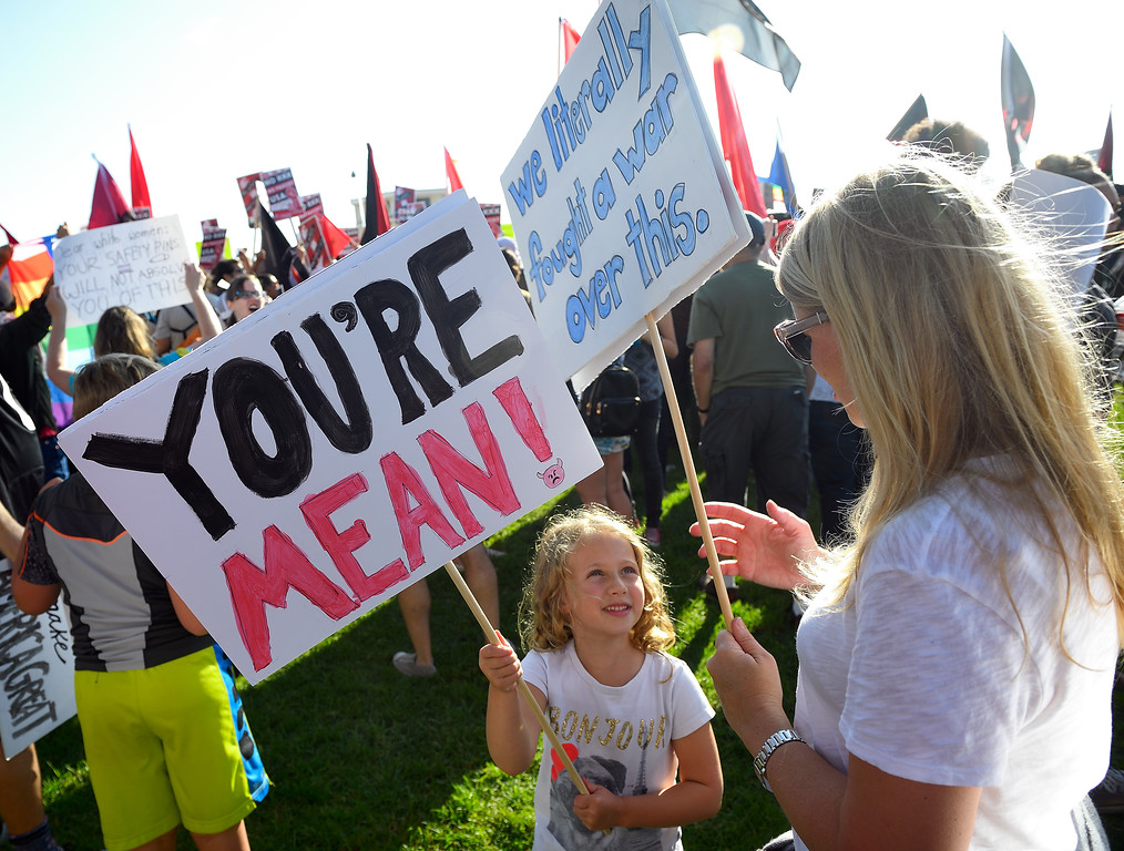 . Zoe Tepper, 5, demonstrates with Anna Viele, of South Pasadena during the demonstration in Laguna Beach. Kevin Sullivan, Orange County Register/SCNG