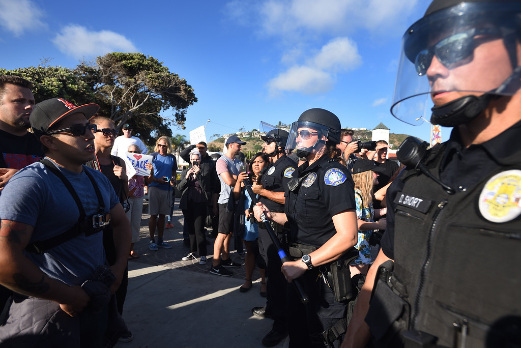 . Police officers from various departments, including Laguna Beach and Huntington Beach, create a line separating the protesters in an attempt to prevent clashes during a demonstration in Laguna Beach. Mindy Schauer, Orange County Register/SCNG
