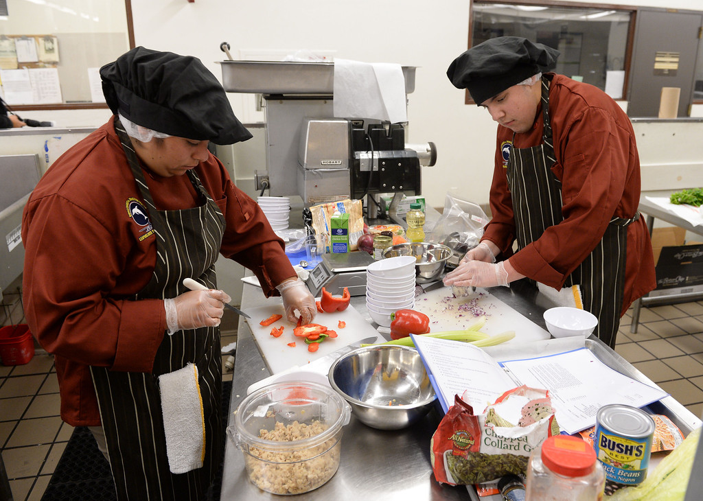 ". LAUSD ""Cooking Up Change\"" culinary competition for high school students held at LA TradeTechnical College. Doyle CTC chefs Cecilia Carrillo, left, and Esteban Tostado chop vegetables for their entry.   (Thurs. Jan 30, 2014 Photo by Brad Graverson/The Daily Breeze)"