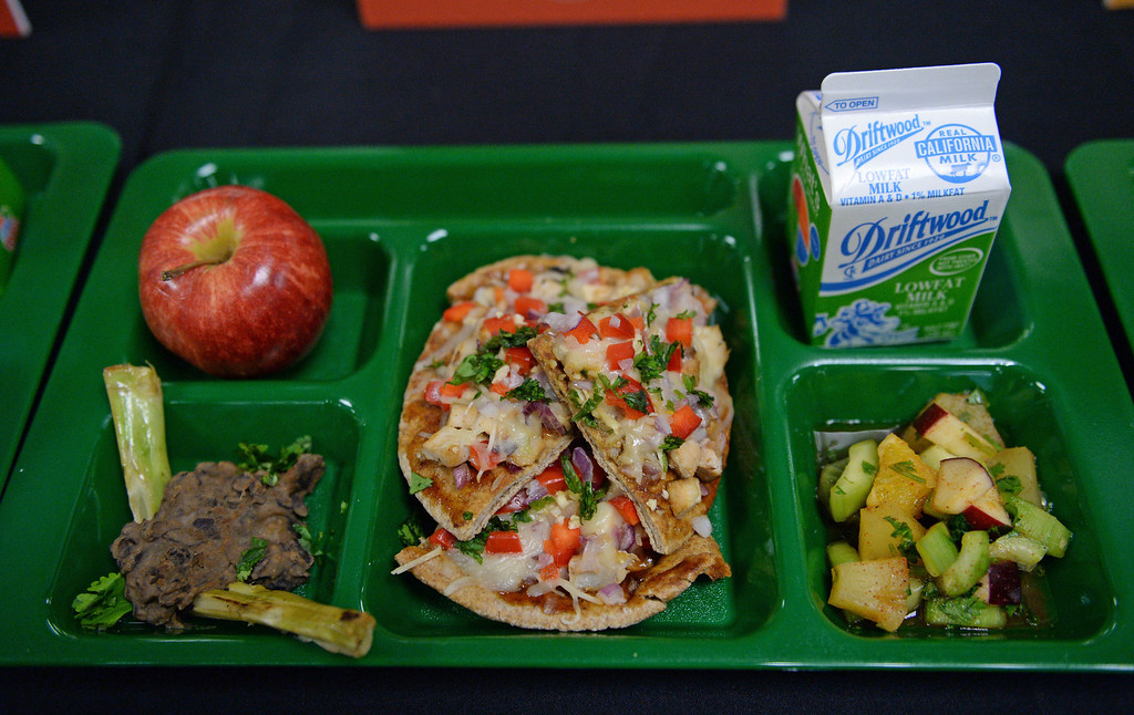 ". LAUSD ""Cooking Up Change\"" culinary competition for high school students held at LA TradeTechnical College.  First place winning entry by chefs from Manual Arts High School are Kimberly Sanchez, and Jenifer Mendez. BBQ Chicken Pizza, Spicy Bean Dip and Tropical C salad. (Thurs. Jan 30, 2014 Photo by Brad Graverson/The Daily Breeze)"