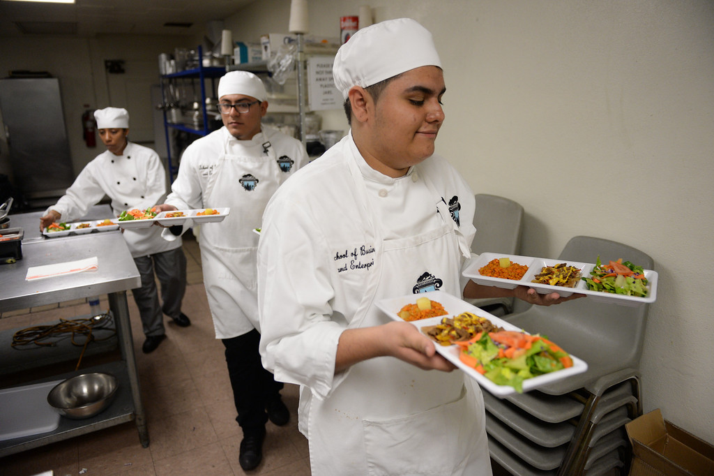 ". LAUSD ""Cooking Up Change\"" culinary competition for high school students held at LA TradeTechnical College. West Adams Prep chefs bring out their creations for judging.  (Thurs. Jan 30, 2014 Photo by Brad Graverson/The Daily Breeze)"