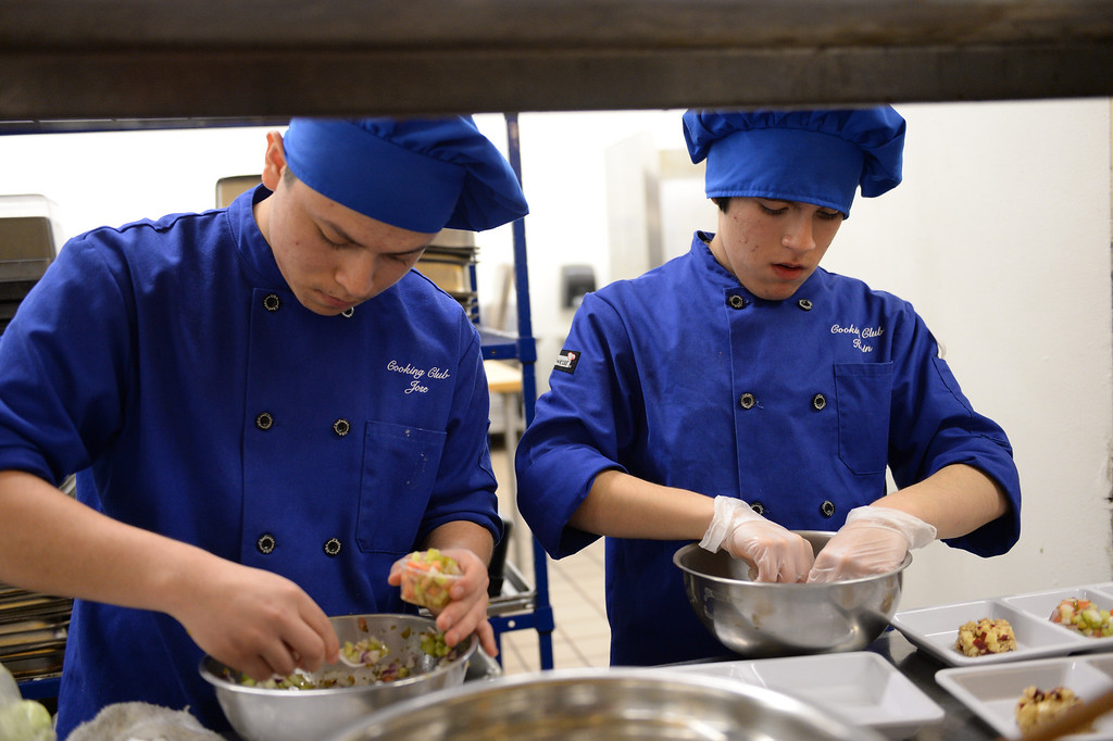 """. LAUSD \""""Cooking Up Change\"""" culinary competition for high school students held at LA TradeTechnical College. Francis Polytechnic HS chefs Jose Garcia, left and Kevin Escobar prepare their entry.  (Thurs. Jan 30, 2014 Photo by Brad Graverson/The Daily Breeze)"""
