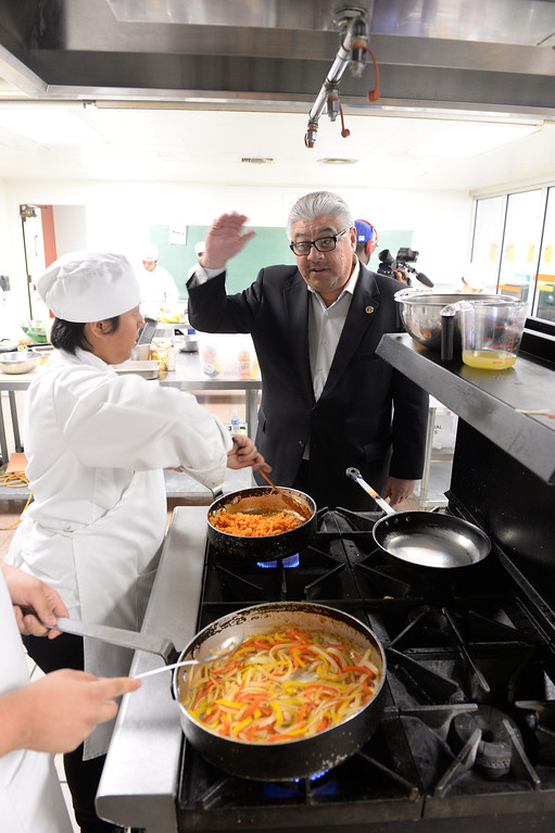 """. LAUSD \""""Cooking Up Change\"""" culinary competition for high school students held at LA TradeTechnical College. Judge Enrique Boull\'t (cq) tours the kitchen as meals are being prepared.  (Thurs. Jan 30, 2014 Photo by Brad Graverson/The Daily Breeze)"""
