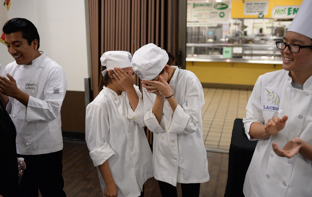 ". LAUSD ""Cooking Up Change\"" culinary competition for high school students held at LA TradeTechnical College.  First place winners from Manual Arts High School are Kimberly Sanchez, left and Jenifer Mendez as their school is called out.(Thurs. Jan 30, 2014 Photo by Brad Graverson/The Daily Breeze)"