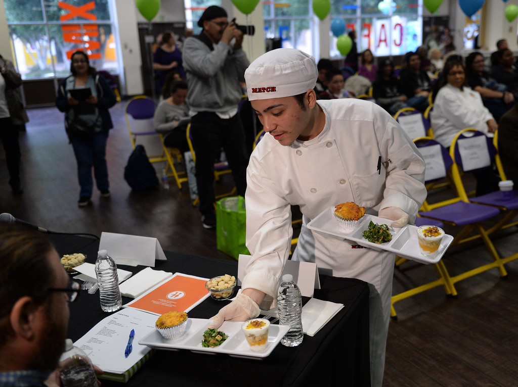 ". LAUSD ""Cooking Up Change\"" culinary competition for high school students held at LA TradeTechnical College. Banning High School chef Bryan Orozco presents his team\'s entry to the judges.  (Thurs. Jan 30, 2014 Photo by Brad Graverson/The Daily Breeze)"