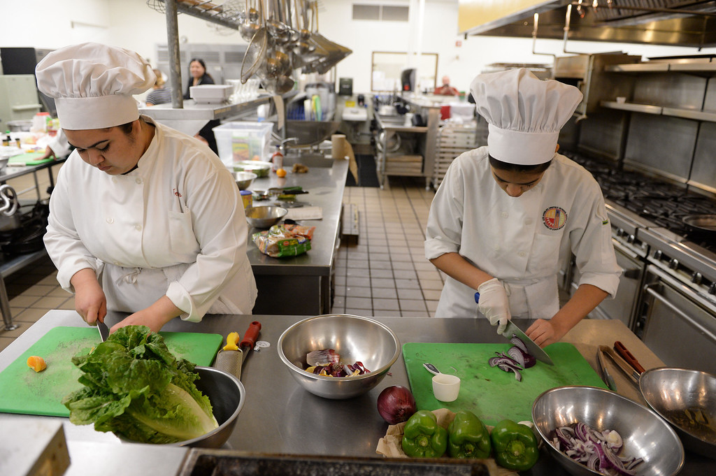 """. LAUSD \""""Cooking Up Change\"""" culinary competition for high school students held at LA TradeTechnical College. Carson HS chefs Cristina Torres, left, and Cecilia Chong.  (Thurs. Jan 30, 2014 Photo by Brad Graverson/The Daily Breeze)"""