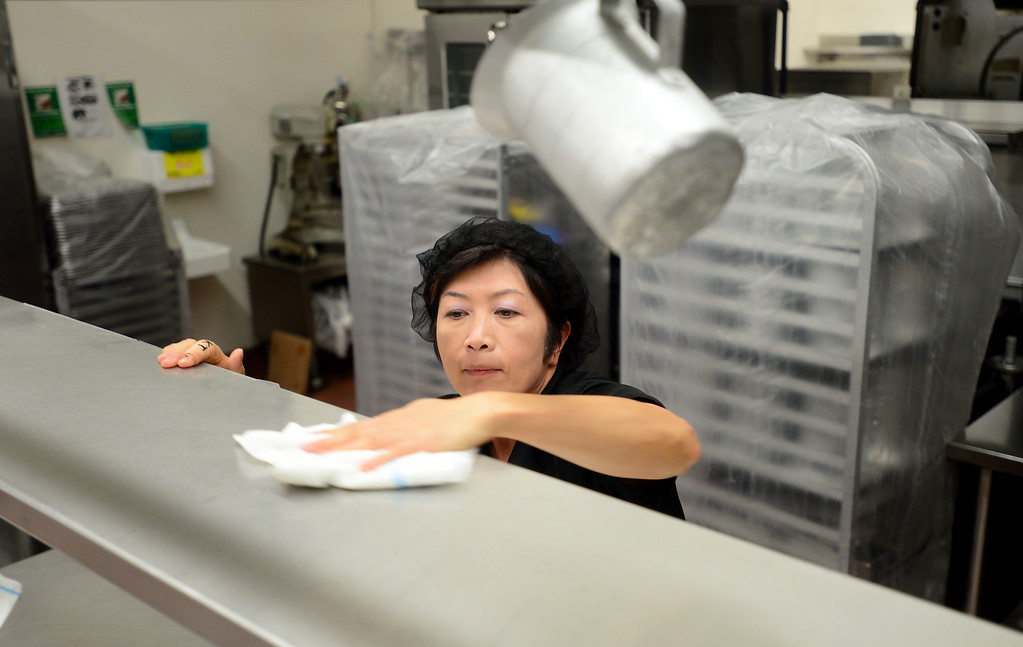 . Nina Cheng cleans surface areas in the kitchen on Friday, August 11, 2017.  LAUSD school food service workers at Nobel Middle School, in Northridge, CA., are preparing for the new school year that starts next Tuesday.  (Photo by Dean Musgrove, Los Angeles Daily News/SCNG)