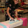 Belya ironing little dresses.