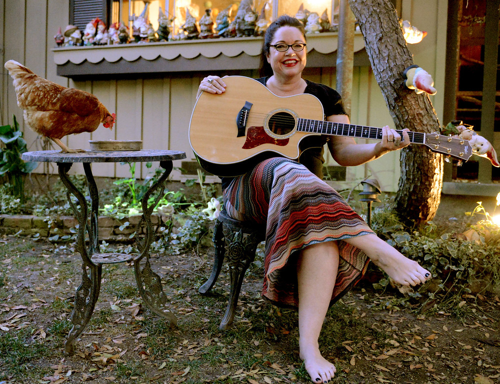 . LPT-L-90808-02-TRC  D.D. Wood with her chicken and guitar in the front yard of her home is the second generation of the same family living in the home in Long Beach Tuesday September 10, 2013.  (Photo by Thomas R. Cordova/ Daily Breeze)  (Photo by Thomas R. Cordova/ Daily Breeze)