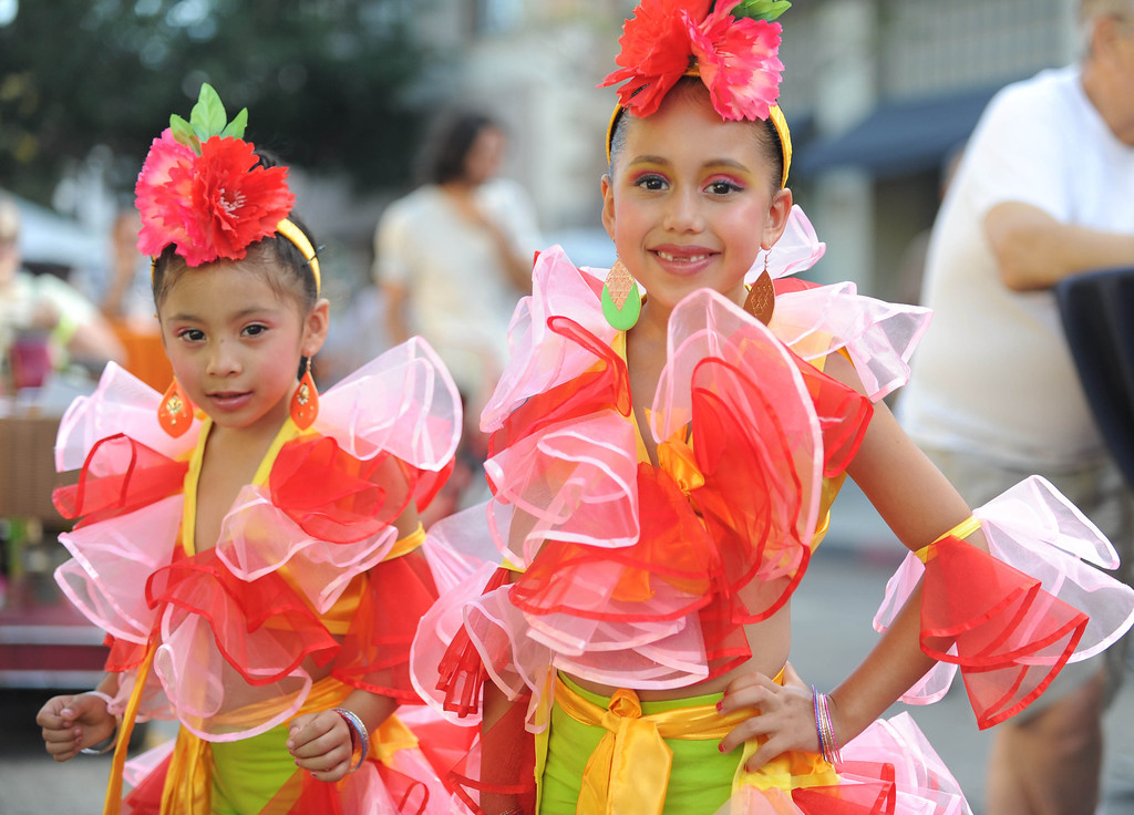 . Arlyn Gonzalez ,4, left, and Deymi Tovar,5, left, get ready to perform at the 5th Annual Latin American Festival on North Pine in Long Beach, CA. on September 7, 2013.(Photo by Sean Hiller/Press Telegram)