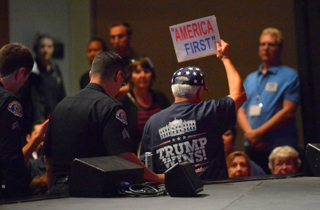 . A Trump supporter is removed from the theatre during Rep. Ted Lieu�s town hall meeting at the Redondo Beach Performing Arts Center in Redondo Beach, CA on Monday, April 24, 2017. The venue was filled primarily with his supporters, but a few vocal conservatives did their best to try to disrupt the gathering. (Photo by Scott Varley, Daily Breeze/SCNG)