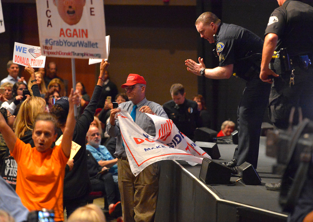 . Redondo police officers try to calm down disruptive audience members during Rep. Ted Lieu�s town hall meeting at the Redondo Beach Performing Arts Center in Redondo Beach, CA on Monday, April 24, 2017. The venue was filled primarily with his supporters, but a few vocal conservatives did their best to try to disrupt the gathering. (Photo by Scott Varley, Daily Breeze/SCNG)