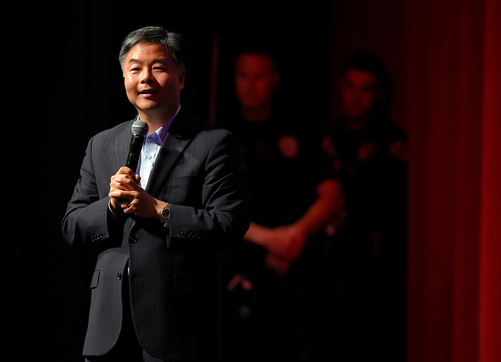 . As police officers watch from the wings, Rep. Ted Lieu holds a town hall meeting at the Redondo Beach Performing Arts Center in Redondo Beach, CA on Monday, April 24, 2017. The venue was filled primarily with his supporters, but a few vocal conservatives did their best to try to disrupt the gathering. (Photo by Scott Varley, Daily Breeze/SCNG)