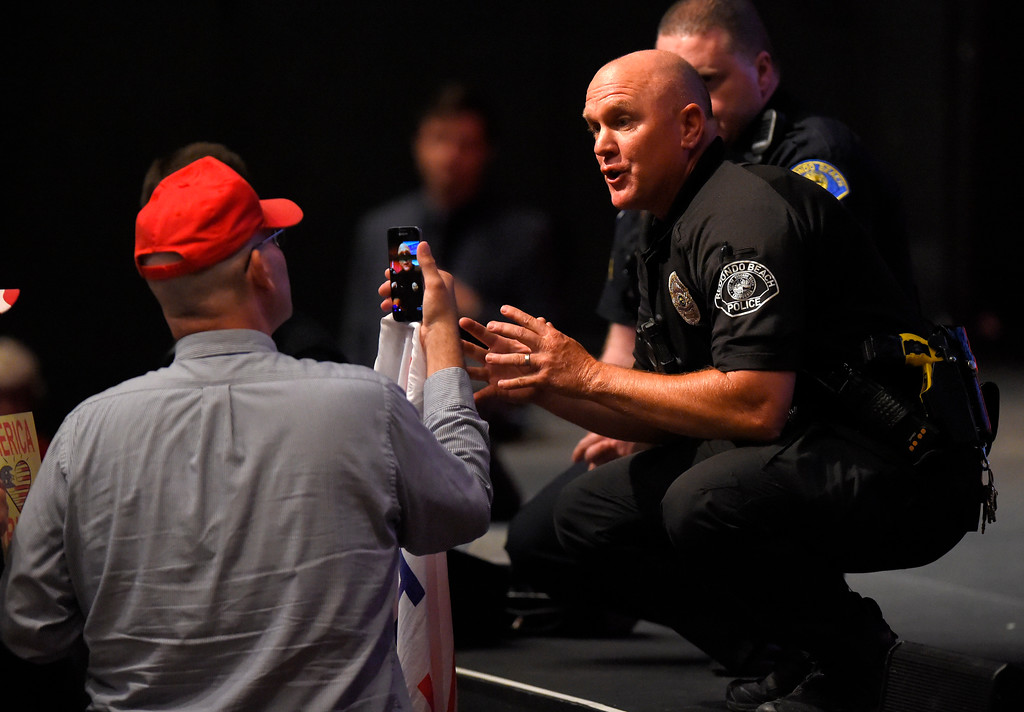 . A Redondo police officer tries to keep order with local political gadfly Arthur Schaper during Rep. Ted Lieu�s town hall meeting at the Redondo Beach Performing Arts Center in Redondo Beach, CA on Monday, April 24, 2017. The venue was filled primarily with his supporters, but a few vocal conservatives did their best to try to disrupt the gathering. (Photo by Scott Varley, Daily Breeze/SCNG)