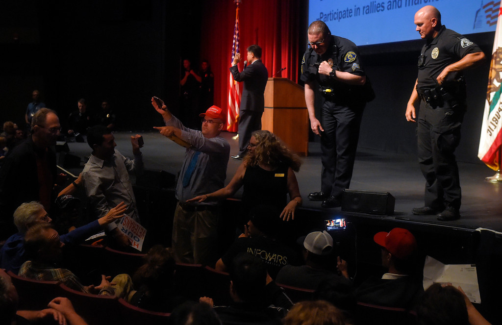 . As Rep. Ted Lieu holds a town hall meeting, Redondo police officer try to keep order between both sides in Redondo Beach, CA on Monday, April 24, 2017. The venue was filled primarily with his supporters, but a few vocal conservatives did their best to try to disrupt the gathering. (Photo by Scott Varley, Daily Breeze/SCNG)