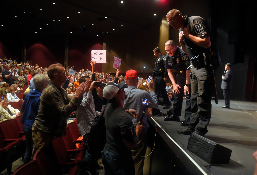. Police officers try to keep the peace between arguing audience members during Rep. Ted Lieu�s town hall meeting at the Redondo Beach Performing Arts Center in Redondo Beach, CA on Monday, April 24, 2017. The venue was filled primarily with his supporters, but a few vocal conservatives did their best to try to disrupt the gathering. (Photo by Scott Varley, Daily Breeze/SCNG)