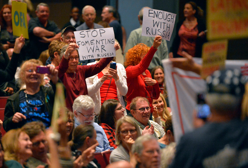 . Audience members have a sign war before Rep. Ted Lieu�s town hall meeting at the Redondo Beach Performing Arts Center in Redondo Beach, CA on Monday, April 24, 2017. The venue was filled primarily with his supporters, but a few vocal conservatives did their best to try to disrupt the gathering. (Photo by Scott Varley, Daily Breeze/SCNG)