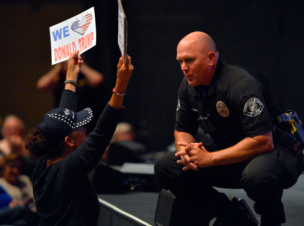 . A Redondo police officer has a talk with a disruptive Trump supporter at Rep. Ted Lieu�s town hall meeting at the Redondo Beach Performing Arts Center in Redondo Beach, CA on Monday, April 24, 2017. The venue was filled primarily with his supporters, but a few vocal conservatives did their best to try to disrupt the gathering. (Photo by Scott Varley, Daily Breeze/SCNG)