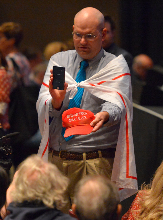 . Arthur Schaper shows off his Trump hat as he tries to engage Lieu supporters before the start of Rep. Ted Lieu�s town hall meeting at the Redondo Beach Performing Arts Center in Redondo Beach, CA on Monday, April 24, 2017. The venue was filled primarily with his supporters, but a few vocal conservatives did their best to try to disrupt the gathering. (Photo by Scott Varley, Daily Breeze/SCNG)